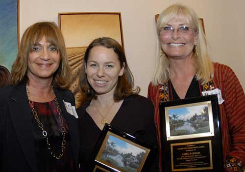 This year's Citizen Appreciation Award was given to Greg Parkos for his many contributions to the Venice Canals Community. VCA Vice President Rene Kaplan (left) presents plaques to January Parkos Arnall and Nadine Parkos.