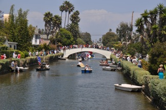 a huge crowd lines the Canal banks and Dell bridge to watch the 8th Annual Rubber Ducky Race and Linnie Canal Downwind Regatta